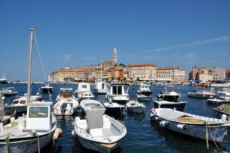 ROVINJ, CROATIA – JULY 30: The harbour of the beautiful town of Rovinj, on JULY 30, 2012 in Istria, Croatia. Rovinj is the pearl of the famous Istria peninsula in Croatia Stock Photo - 17268914