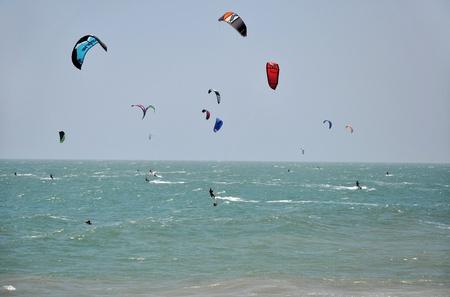 kiter: Kite surfers kite surfing in Mui Ne, Vietnam