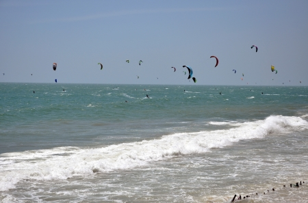 ne: Kite surfers kite surfing in Mui Ne, Vietnam