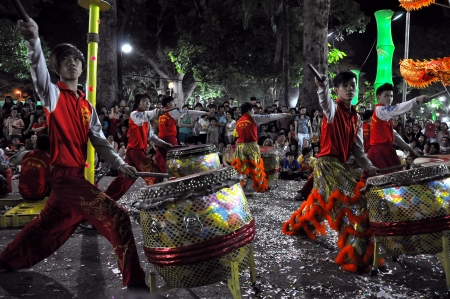 Musicians playing on their drums at the Tet Lunar New Year celebrations, Saigon, Vietnam