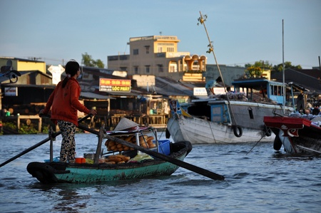 cai rang: Vietnamese woman selling goods in the Cai Rang floating market, Mekong Delta, Vietnam