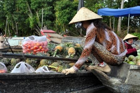 march� flottant: Vendeurs de bateaux � Can Tho march� flottant, Delta du M�kong, Vietnam