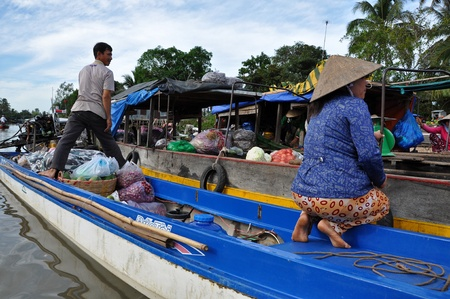 CAN THO - FEB 17: Unidentified fruit sellers at the Floating Market. With hundreds of boats, Cai Rang is the biggest floating market in the Mekong Delta. On Feb. 17, 2013, in Can Tho, Vietnam