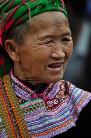 Black Hmong minorty woman selling her goods in Bac Ha market, Vietnam