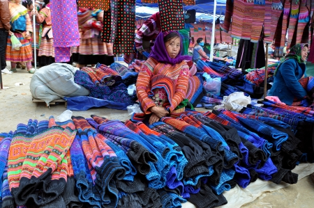 Black Hmong minorty woman selling textile in Bac Ha market, Vietnam