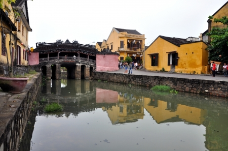 HOI AN - MARCH 3: Unidentified tourists visiting the famous Japanese bridge, Hoi An. In Hoi An there are more than 800 Unesco heritage buildings. Vietnam