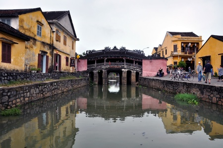HOI AN - MARCH 3: Unidentified tourists visiting the famous Japanese bridge, Hoi An. In Hoi An are more than 800 Unesco heritage buildings. Vietnam