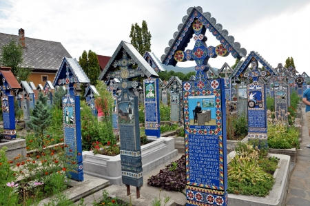 Sapanta, Romania, July 21, 2012 - Carved and wooden crosses in the Merry Cemetery. Unesco heritage site