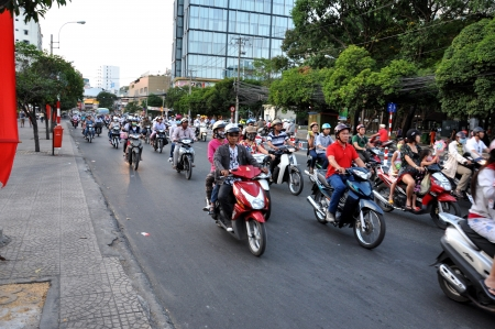 chaotically: Saigon, Vietnam - February 15, 2013: Chaotically road traffic in Ho Chi Minh, the traffic is often congested