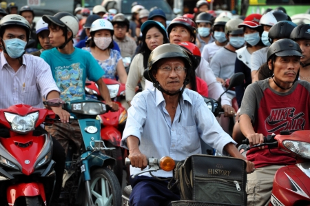 Saigon, Vietnam - February 15, 2013: Chaotically road traffic in Ho Chi Minh, the traffic is often congested