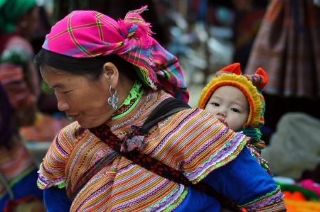 Bac Ha, Vietnam, February 23, 2013 - Hmong woman carrying her child in Bac Ha market, Vietnam