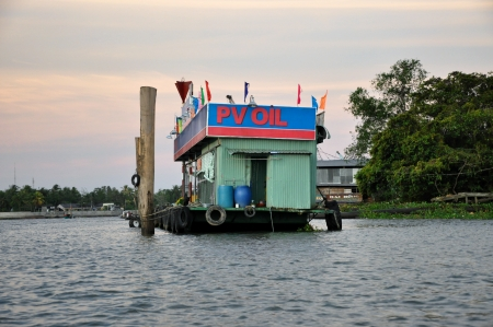 can tho: Can Tho, Vietnam - February 17, 2013: Floating gasoline station in the Mekong delta