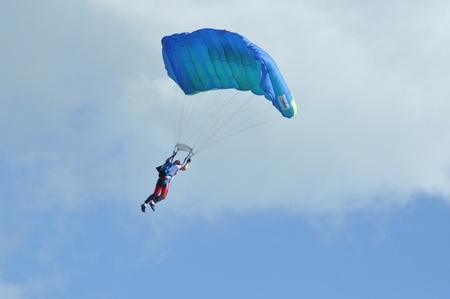 parachutists: Parachutists flying in the air at the Romanian Air Fest on May 18, 2013 in Cluj Napoca, Romania