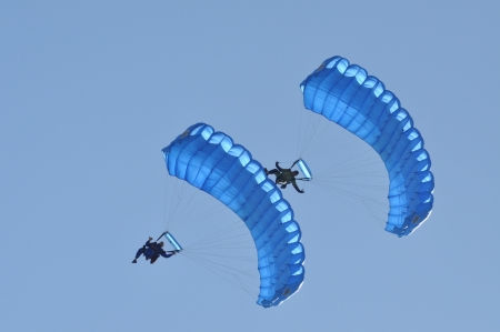Parachutists flying in the air at the Romanian Air Fest on May 18, 2013 in Cluj Napoca, Romania