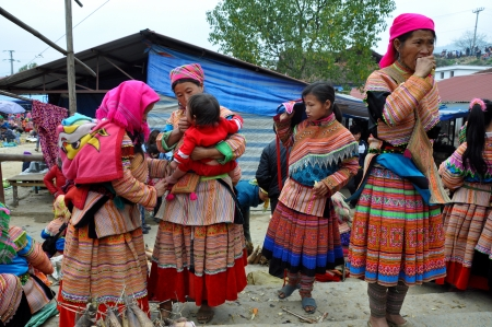 Hmong seller women in traditional clothes selling their goods in Bac Ha market, Sapa, Vietnam