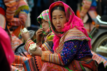 A Hmong seller woman in traditional clothes in Sapa, Vietnam