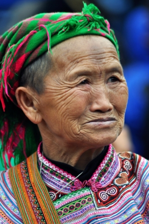 A Hmong seller woman in traditional clothes in Bac Ha, Sa Pa, Vietnam