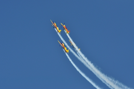 CLUJ NAPOCA, ROMANIA, MAY 18, 2013 - A group of aircraft in-flight smoke color at the Romanian Military Parade
