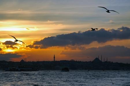 Sunset over Bosphorus, Sultanahmet in the background, Istanbul, Turkey photo