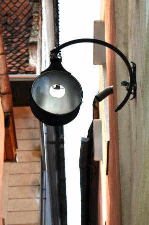 Street lamp on a narrow street  Brasov, Romania photo