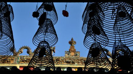 Silhouette of hanging incense coils in a temple, Vietnam photo