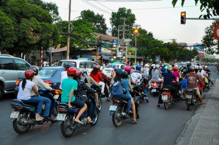 chaotically: HO CHI MINH - FEB15: Chaotic road traffic in Saigon, Vietnam. In the biggest city in Southern Vietnam are more than 4 mil. motorbikes, the traffic is often congested. Feb 15, 2013, Saigon, Vietnam