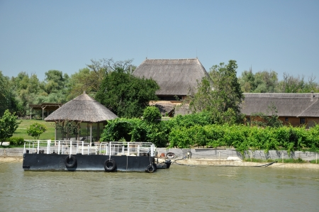 Traditional houses with thatched roof in the Danube delta, Romania photo