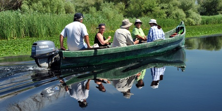 danubian: SULINA - JUNE 25: Unidentified people take boat trip with a local ranger in the Danube Delta Biosphere Reserve. Danube delta is the second largest river delta in Europe. On June 25 in Sulina, Romania   Editorial