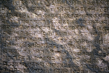 sanskrit: Background with ancient sanskrit text etched into a stone tablet Stock Photo