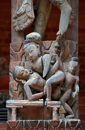 Erotic carving, explicit Kama Sutra position on a Nepalese temple in Patan, Kathmandu, Nepal Stock Photo - 23246424