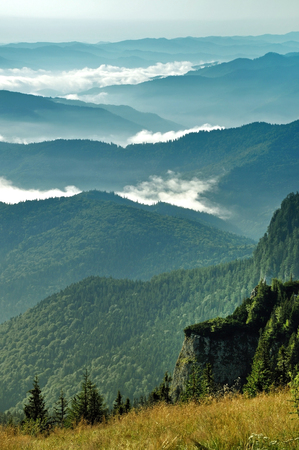 Misty morning in the Ceahlau mountains, Romania Stock Photo