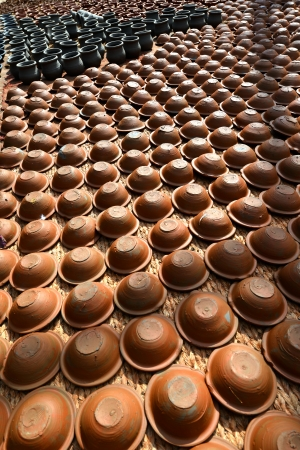 Rows of handmade traditional potteries in Bhaktapur, Nepal photo