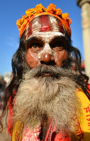 alleged: KATHMANDU -OCT 11  Sadhu man with painted face in Kathmandu  They are holy men who have chosen to live an ascetic life and focus on the spiritual practice of Hinduism  Oct 11, 2013 in Kathmandu, Nepal Editorial