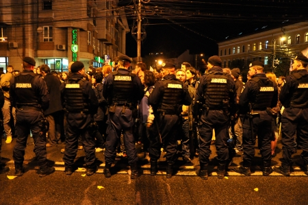 counter terrorism: CLUJ - NOV 3  Romanian Gendarmerie and Police trying to stop the protesters against the Romanian Government and gold mining with cyanide technologies in Rosia Montana  On Nov 3, 2013 in Cluj, Romania