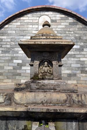 Graved statue of God Shiva on a public stone fountain  Pashupatinath, Nepal Stock Photo - 23454456