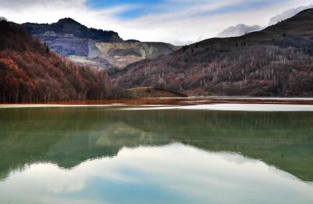 Contaminated water in a lake near an open cast copper mine  Geamana, Romania photo
