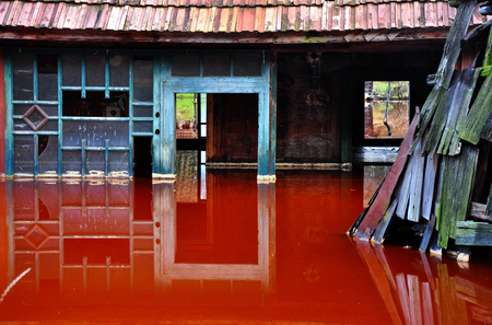 Ecological disaster  An abandoned village flooded by polluted water from a copper open pit mine photo