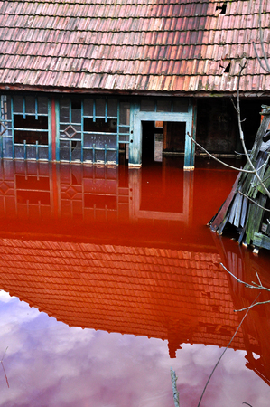 Ecological disaster  An abandoned village flooded by polluted water from a copper open pit mine Stock Photo - 24037119
