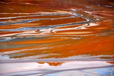 Abstract image of copper mining residuals in a lake  Ecological catastrophe in Geamana, Romania photo