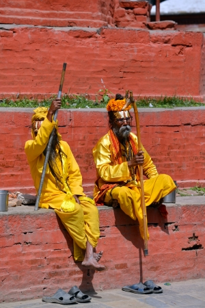 KATHMANDU - OCT 10  Shaiva sadhu men seeking alms in the Durbar square  On Oct 10, 2013 in Kathmandu, Nepal  Sadhus are holy men who are focusing on the spiritual practice of Hinduism