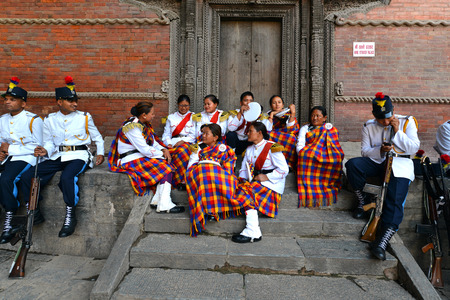 KATHMANDU - OCT 11  Musicians of the Nepalese Military Orchestra waiting for the show, in the inner courtyard of the Royal Palace, during the Dasain festival  On October 11, 2013 in Kathmandu, Nepal