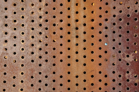 Rusty iron background with holes photo