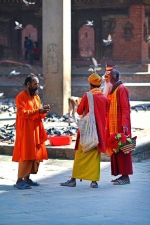 KATHMANDU - OCT 10  Shaiva sadhu men seeking alms in the Durbar square  On Oct 10, 2013 in Kathmandu, Nepal  Sadhus are holy men who are focusing on the spiritual practice of Hinduism Stock Photo - 24484149