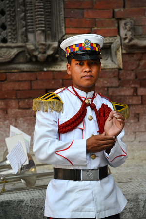 KATHMANDU - OCT 11  Musician of the Nepalese Military Orchestra waiting for the show, in the inner courtyard of the Royal Palace, during the Dasain festival  On October 11, 2013 in Kathmandu, Nepal