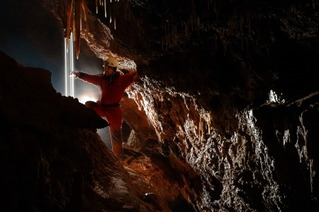 cave exploring: Cave explorer, speleologist exploring the underground