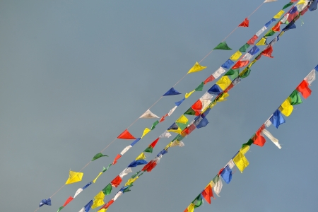 Buddhist Tibetan prayer flags blowing in the wind  photo