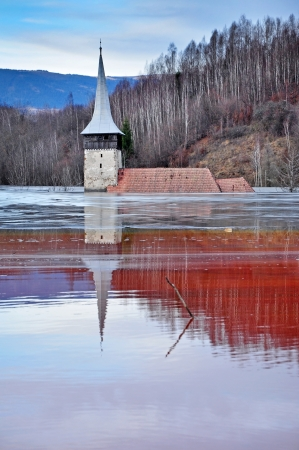 residual: Abandoned church in the middle of a lake full with mining residuals from a copper mine Stock Photo