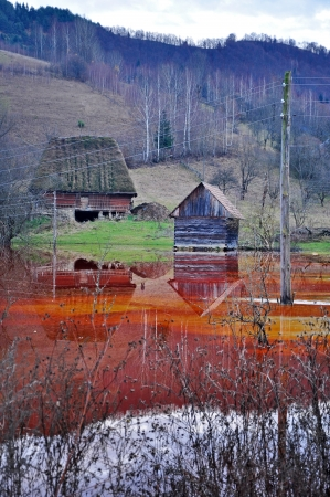An abandoned house flooded by polluted water from a copper open cast mine Stock Photo - 24914791