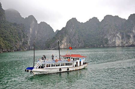 natural wonders: HALONG BAY – FEB 27  Tourist junks navigating through the karst islands in Halong Bay  This is one of Vietnam