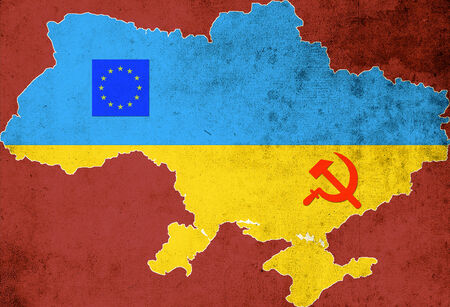 The map and the flag of Ukraine on a red background photo